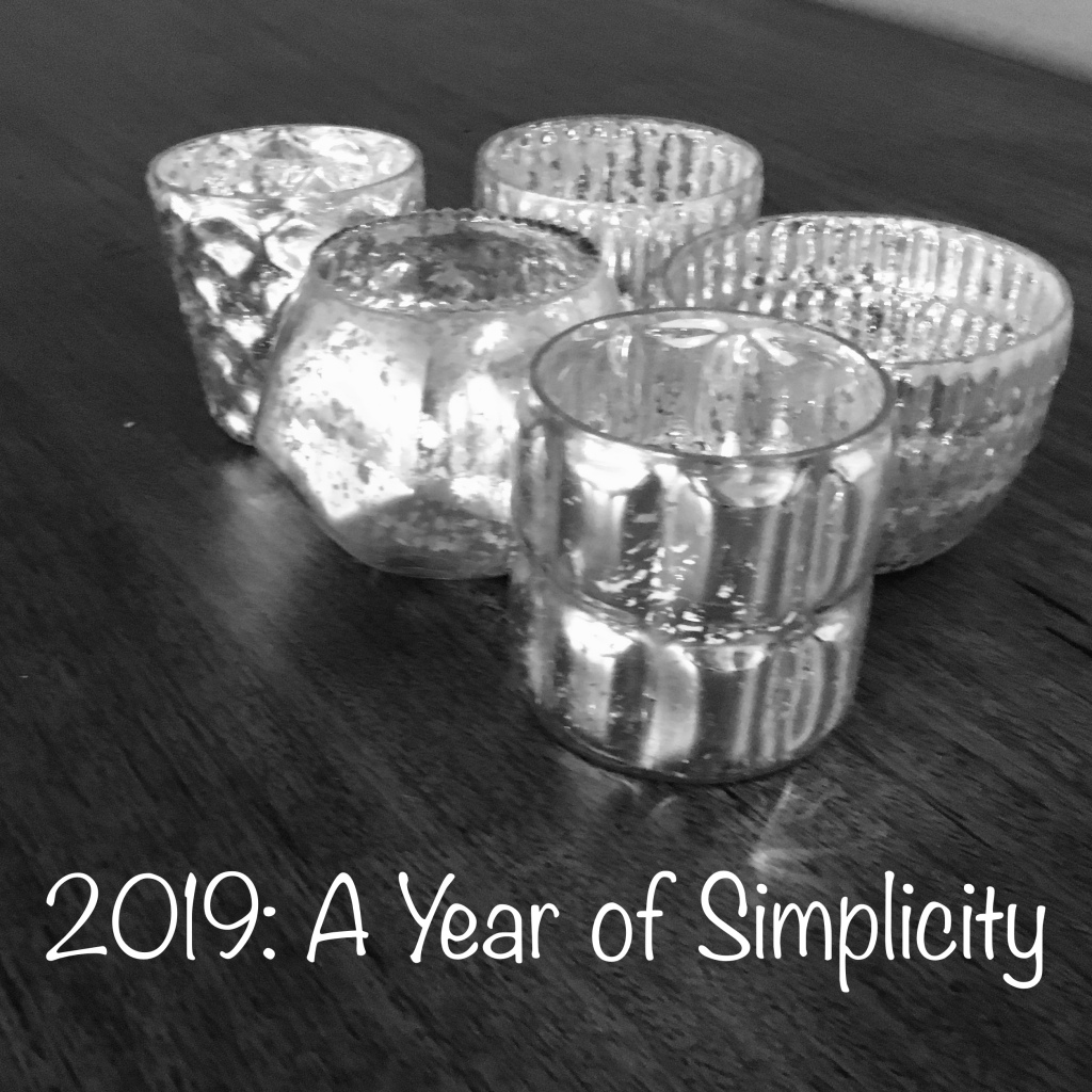 "five candle holders sitting on a table with the text ""2019: A Year of Simplicity"""