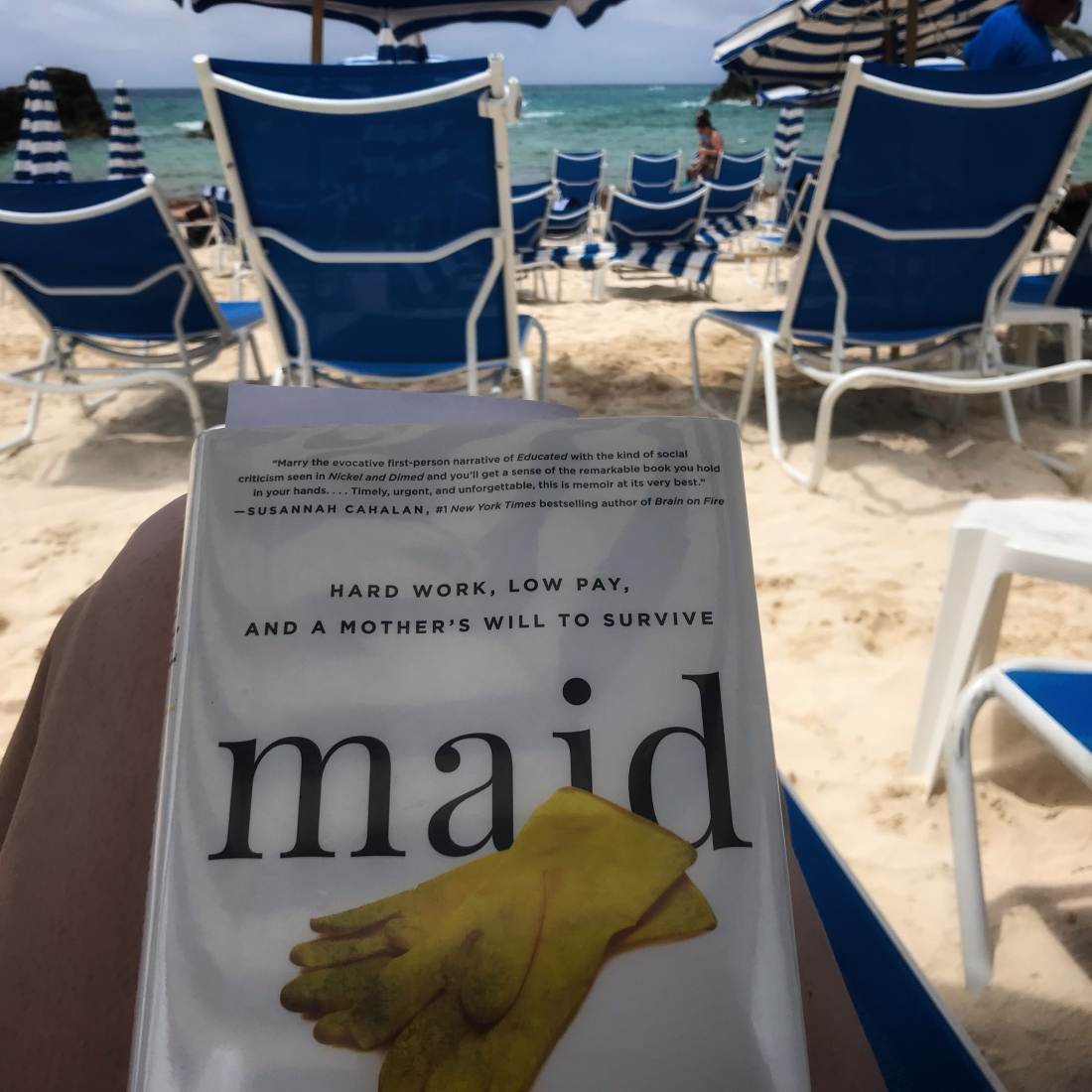 The book in my lap with the ocean in the background